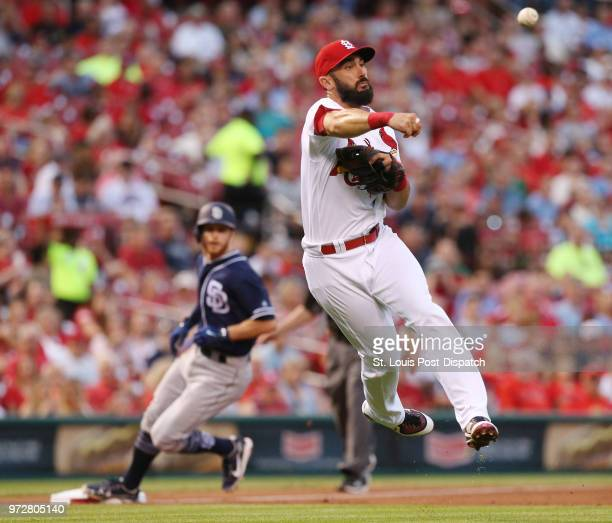 St Louis Cardinals third baseman Matt Carpenter throws to first base on an infield single by the San Diego Padres' Manuel Margot to load the bases in...