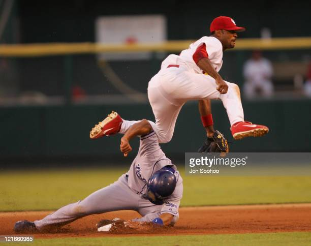 St Louis Cardinals Tony Womackin white throws the ball to first base as Los Angeles Dodgers Alex Cora tries to disrupt the play on the 5th inning...