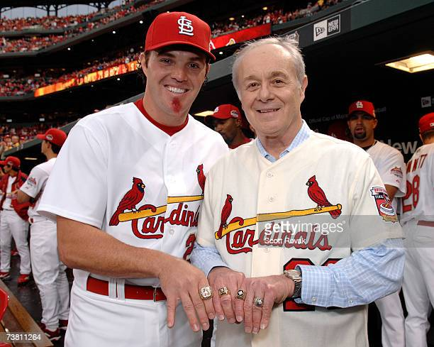 St Louis Cardinals utility player Scott Spiezio and his father Ed show off their championship rings before the game against the New York Mets at...