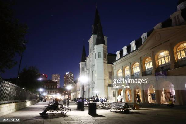 St Louis Cathedral is illuminated at dusk in Jackson Square on April 16 2018 in New Orleans Louisiana The square is the oldest space of the city and...