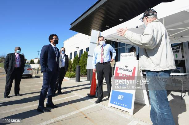 St. Louis County Prosecutor Wesley Bell listens to a concerned voter after casting his ballot on November 3, 2020 outside the St. Louis County Board...