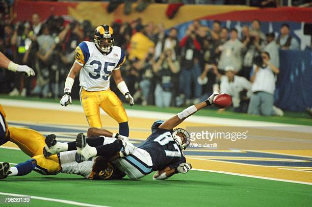 St Louis LB Mike Jones tackles Tennessee WR Kevin Dyson just short of the goal line on the last play of the game during Super Bowl XXXIV at the...
