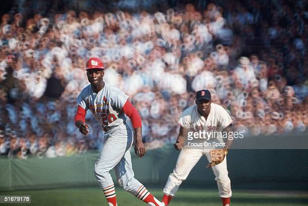 St Louis' Lou Brock leads off of first base against the Boston Red Sox during the 1967 World Series at Fenway Park Boston Massachusetts