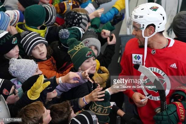 Minnesota Wild left wing Jordan Greenway signed autographs following the Wild's outdoor practice Thursday