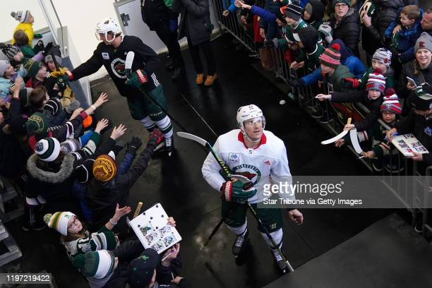 Minnesota Wild left wing Marcus Foligno looked to throw a puck to a fan following the Wild's outdoor practice Thursday