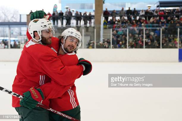Minnesota Wild right wing Mats Zuccarello celebrated with center Luke Kunin after they scored on goaltender Devan Dubnyk during the Wild's outdoor...
