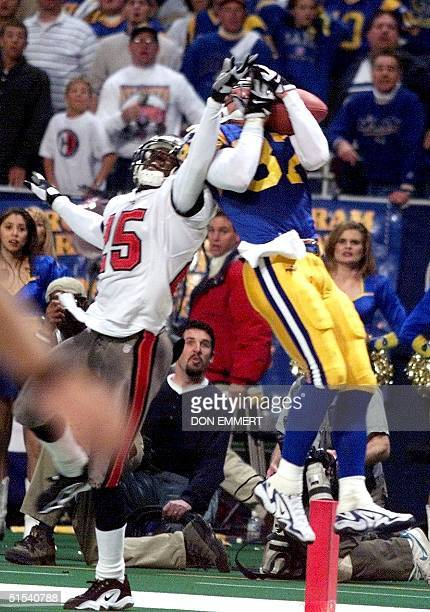 St Louis Ram Ricky Proehl comes down with a fourth quarter winning touchdown in front of Tampa Bay Buccaneer Brian Kelly 23 January during the NFC...
