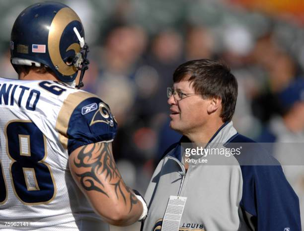 St. Louis Rams assistant offensive line coach Jim Chaney talks with Ritchie Incognito during 20-0 victory over the Oakland Raiders at McAfee Coliseum...
