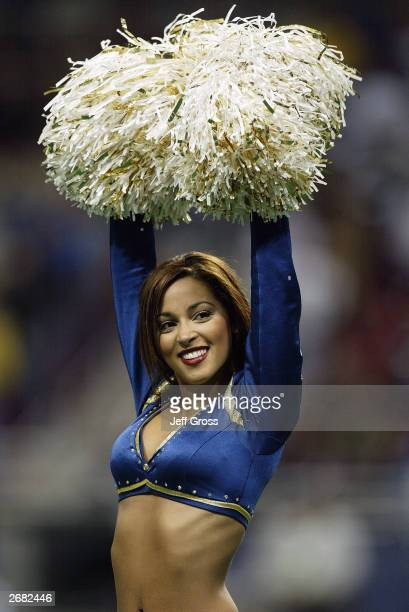 St Louis Rams cheerleader raises her arms during a game between the Arizona Cardinals on September 28 2003 at the Edward Jones Dome in St Louis...