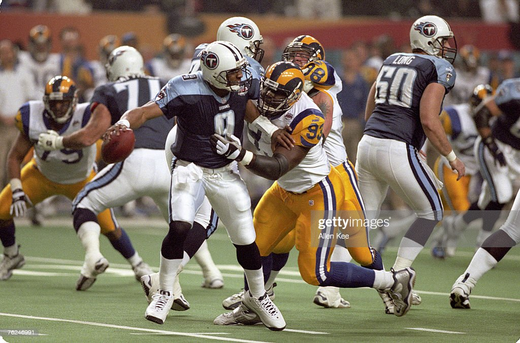 St. Louis Rams defensive end Kevin Carter (93) pressures Tennesee Titans quarterback Steve McNair (9) during Super Bowl XXXIV, a 23-16 St. Louis Rams victory over the Tennesee Titans on January 30, 2000, at the Louisiana Superdome in Atlanta, Georgia.