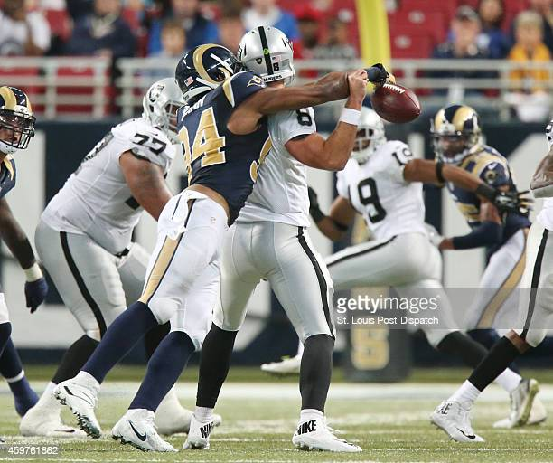 St Louis Rams defensive end Robert Quinn sacks Oakland Raiders quarterback Matt Schaub and forces a fumble that was recovered by the Rams during...