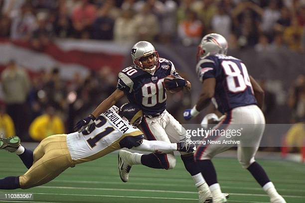 St Louis Rams player ADAM ARCHULETA dives to tackle New England Patriots TROY BROWN number 80 Exact date and location unknown