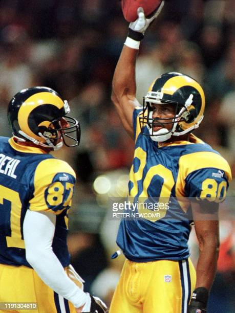 St Louis Rams player Issac Bruce celebrates his first qaurter touchdown reception against the Cleveland Browns with teammate Ricky Proehl The Rams...