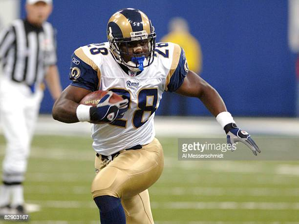 St Louis Rams running back Marshall Faulk rushes upfield against the Indianapolis Colts October 17 2005 in Indianapolis The Colts defeated the Rams...