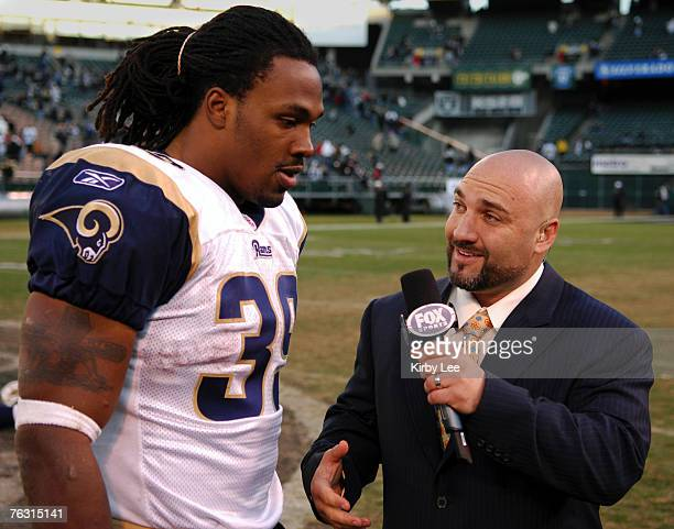 St Louis Rams running back Steven Jackson is interviewed by Jay Glazer of Fox Sports after 200 victory over the Oakland Raiders at McAfee Coliseum in...