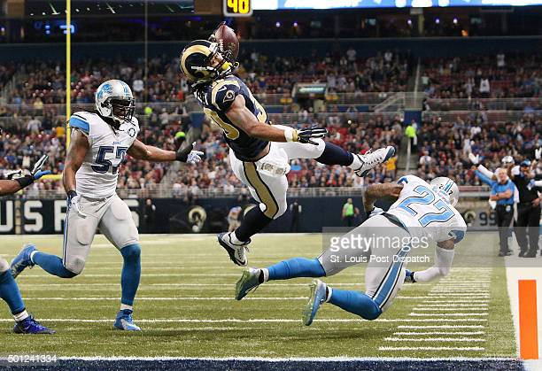 St Louis Rams running back Todd Gurley scores on a fiveyard touchdown run over Detroit Lions safety Glover Quin during third quarter action on Sunday...