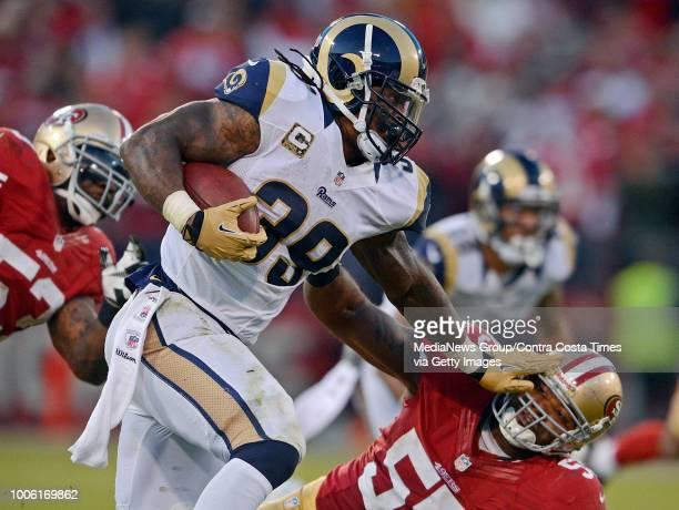 4c73ea37 St. Louis Rams' Steven Jackson stiff arms San Francisco 49ers' Ahmad ...