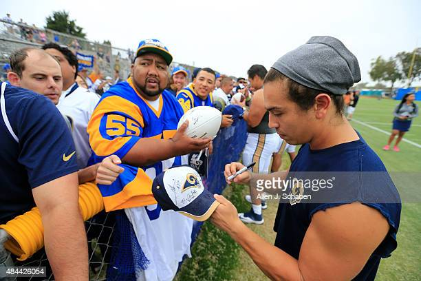 OXNARD CALIF MONDAY AUGUST 17 2015 St Louis Rams wide receiver and US Army veteran Daniel Rodriguez signs autographs for hopeful Los Angeles Rams...