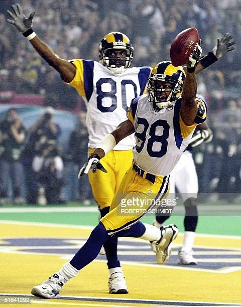 St Louis Rams wide receiver Torry Holt and wide receiver Isaac Bruce celebrate Holt's touchdown catch during second half action in Super Bowl XXXIV...