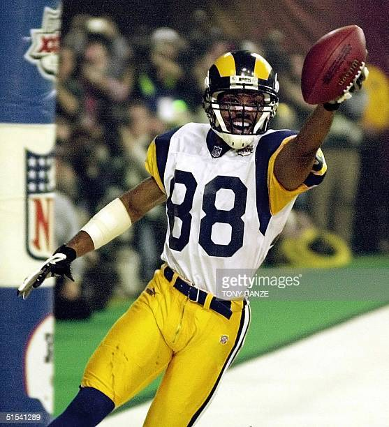 St Louis Rams wide receiver Torry Holt holds the ball in celebration of his touchdown catch during second half action in Super Bowl XXXIV at the...