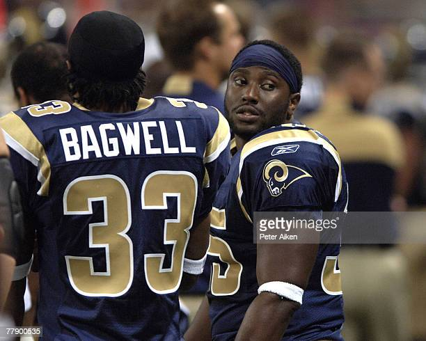 St Louis running back John David Washington the son of actor Denzel Washington stands along side teammate Antoine Bagwell on the sidelines at the...