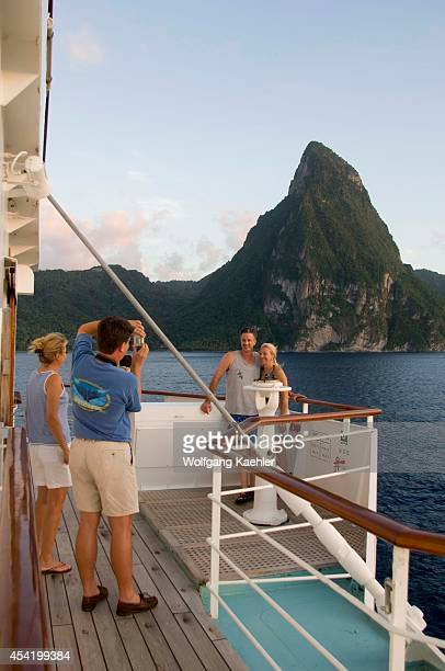 St Lucia Island View Of Island Cruise Ship Wind Surf Passengers On Deck Photographing Piton Peak In Background Model Releases 005 Model Releases 006...