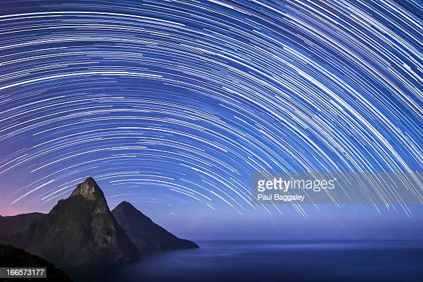st lucia & the pitons - startrails - star trail stock pictures, royalty-free photos & images