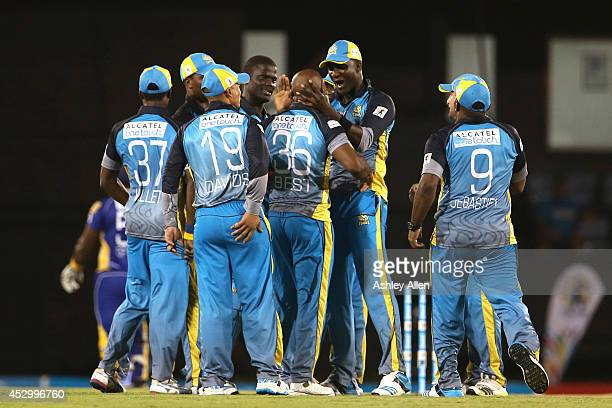 St Lucia Zouks celebrate the wicket of Dwayne Smith during a match between St Lucia Zouks and Barbados Tridents as part of week 4 of the Limacol...