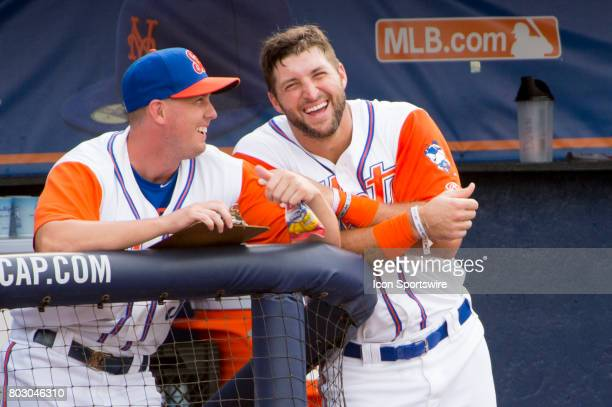 St Lucie Mets Outfielder Tim Tebow laughs with a team mate in the dugout during the second game of a double header MiLB minor league baseball game...
