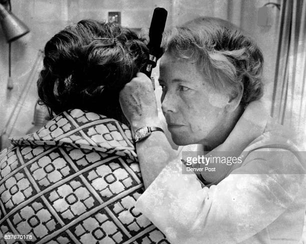 St Lukes Geriatric Nurse Practitioner At Work Erika Saak RN uses an atoscope to examine a patient's ears at the hospitals new Senior Citizen Health...