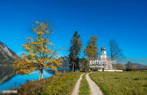 St. Margareth church in autumn, Zwergern peninsula, lake Walchensee, Upper Bavaria, Bavaria, Germany