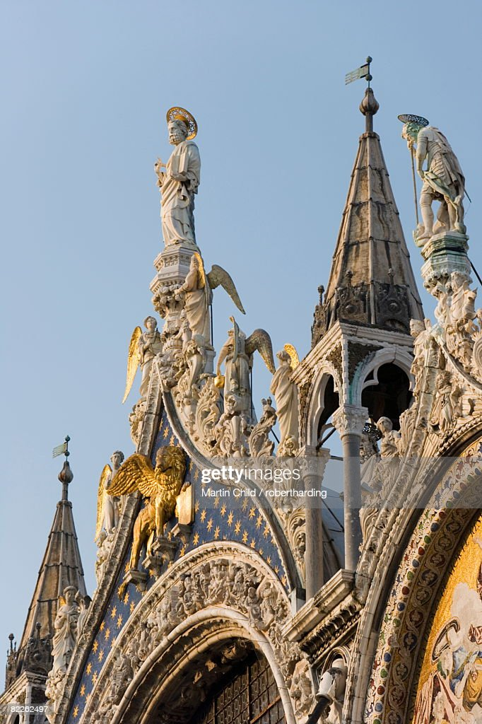St. Mark and angels, detail of the facade of Basilica di San Marco (St. Mark's Basilica), St. Mark's Square, Venice, UNESCO World Heritage Site, Veneto, Italy, Europe : Stock Photo