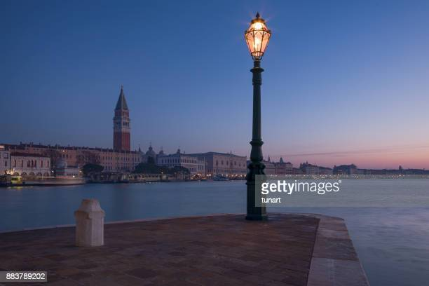 st. mark cathedral and its bell tower, venice, italy - basilica di san marco foto e immagini stock