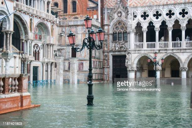 St Mark's square is covered in water during an exceptional high tide on November 13 2019 in Venice Italy Venice second highest tide after 1966 leaves...