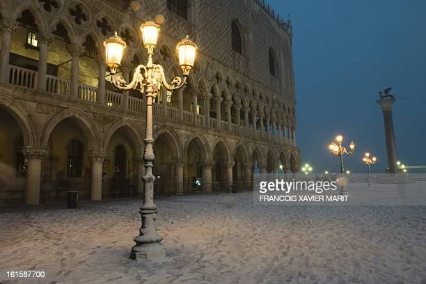 St Mark's square is covered with snow during the carnival on February 11 2013 in Venice The 2013 edition of the Venice carnival is untitled ' Live in...