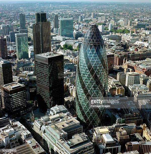 30 St Mary Axe City of London 2000s Aerial view of the 'Gherkin' and the surrounding business district The building was previously named the Swiss Re...