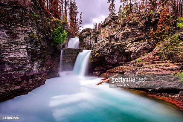 st. mary falls in glacier national park - capital cities stock photos and pictures