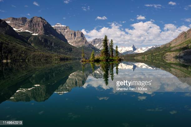 st mary lake in glacier national park - mary lake stock photos and pictures