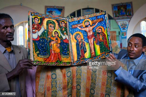 St Mary of Zion church Aksum Ethiopia Priests show the sacred books of the new church of St Mary of Zion in Axum Ethiopian churches have several...