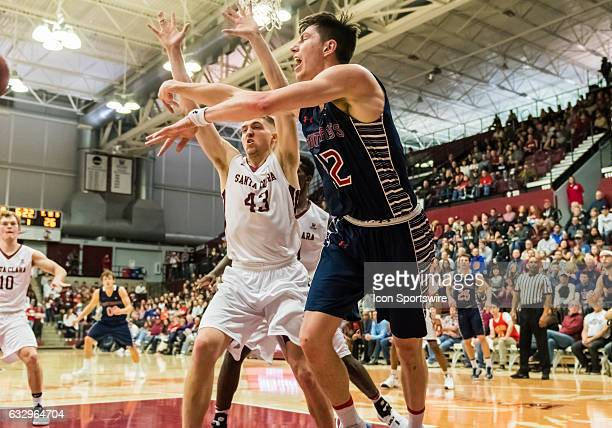St Mary's Gaels forward Dane Pineau gets the ball out from under Santa Clara Broncos forward Nate Kratch during the regular season game between the...