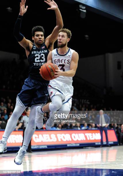 St Mary's Gaels guard Jordan Ford goes up in the air for a lay up as he is guarded by Brigham Young Cougars forward Yoeli Childs during the game...