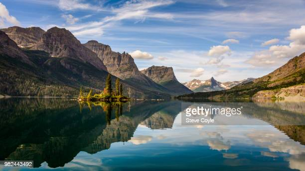 st mary's lake reflecting mountains in glacier national park, montana, usa - mary lake stock photos and pictures