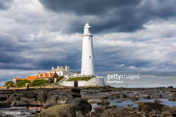 st mary's lighthouse on the seafront, whitley bay - whitley bay stock pictures, royalty-free photos & images