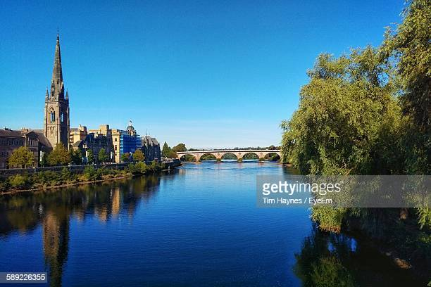 st matthew church and old bridge over river against sky - perth scotland stock pictures, royalty-free photos & images