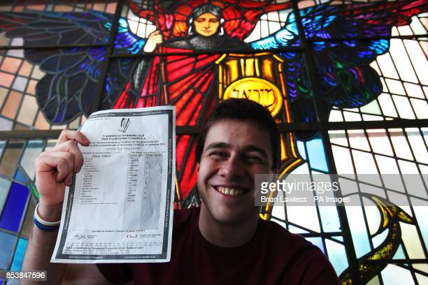St Michael's College student Conor Gallagher from Ballsbridge Dublin with his leaving certificate results of nine higher level A1s in front of a...
