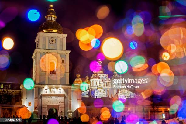 St Michael's GoldenDomed Monastery the main church of the new Orthodox Church of Ukraine is seen through colored lights on Orthodox Christmas Eve on...