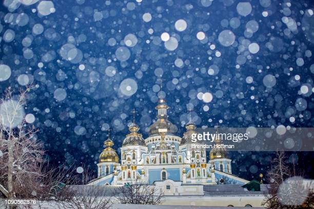 St Michael's GoldenDomed Monastery the main church of the new Orthodox Church of Ukraine in the snow on Orthodox Christmas Eve on January 6 2019 in...