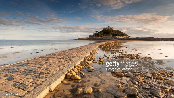st micheal's mount a view from the causeway. - abby road stock photos and pictures
