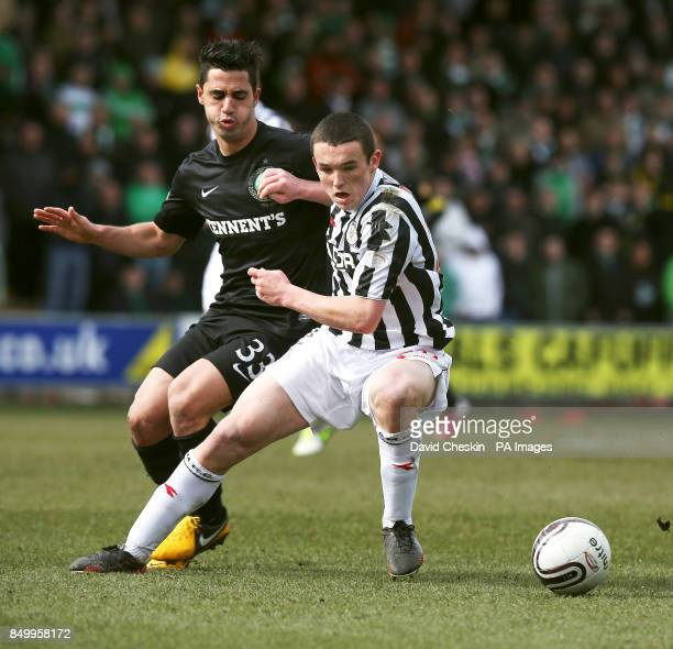 St Mirren's John Mcginn holds off Celtic's Beram Kayal during the Clydesdale Bank Scottish Premier League match at St Mirren Park Paisley
