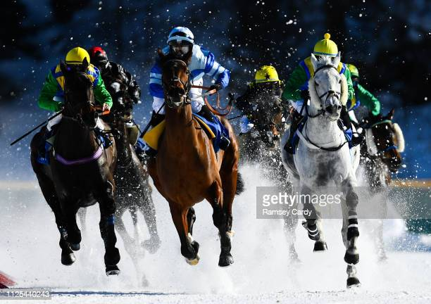 St Moritz Switzerland 17 February 2019 Heloagain with Silvia Casanova blue silks up lead the field on their way to winning the GP Guardaval...